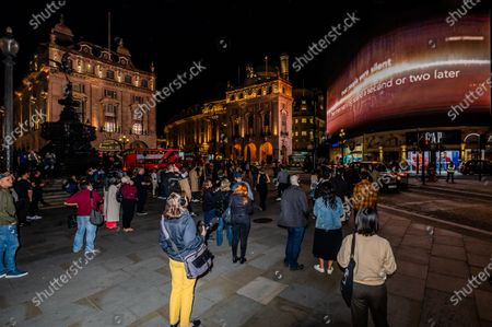 Editorial photo of I Saw The World End by Es Devlin and Machiko Weston on the Piccadilly Lights to mark United Nations International Day of Peace., Piccadilly Circus, London, UK - 21 Sep 2020