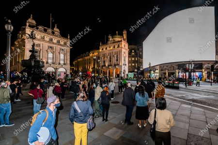 Editorial picture of I Saw The World End by Es Devlin and Machiko Weston on the Piccadilly Lights to mark United Nations International Day of Peace., Piccadilly Circus, London, UK - 21 Sep 2020