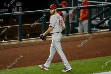 Philadelphia Phillies starting pitcher Zack Wheeler walks to the dugout after he was pulled during the sixth inning of a baseball game against the Washington Nationals, in Washington