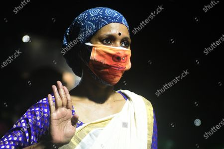 An actor of Purbo Paschim theatre group uses a face-mask going with their character's ensemble during the final dress rehearsal of 'Jwarasur Badh Pala', at Eastern Zonal Cultural Centre (EZCC) on September 20, 2020 in Kolkata, India.  The play is based on how Hindu goddess Durga and Lord Shiva destroy demon Jwarasur (coronavirus) and will be staged on September 21-22 at EZCC.