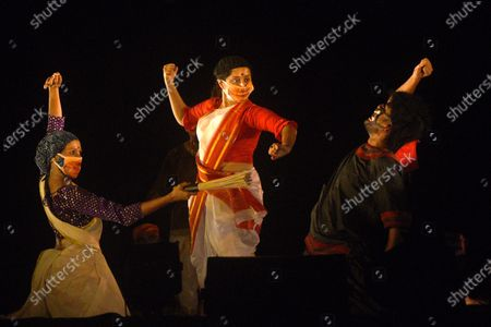 Actors of Purbo Paschim theatre group use face-masks going with their character's ensemble during the final dress rehearsal of 'Jwarasur Badh Pala', at Eastern Zonal Cultural Centre (EZCC) on September 20, 2020 in Kolkata, India.  The play is based on how Hindu goddess Durga and Lord Shiva destroy demon Jwarasur (coronavirus) and will be staged on September 21-22 at EZCC.