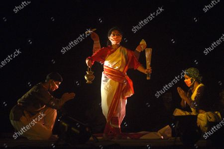 A scene from the Purbo Paschim theatre group's final dress rehearsal of 'Jwarasur Badh Pala', at Eastern Zonal Cultural Centre (EZCC) on September 20, 2020 in Kolkata, India.  The play is based on how Hindu goddess Durga and Lord Shiva destroy demon Jwarasur (coronavirus) and will be staged on September 21-22 at EZCC.