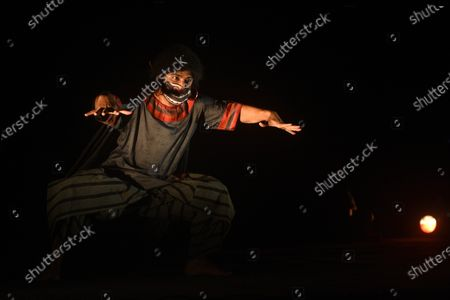 A scene from the dress rehearsal of Purbo Paschim theatre group's production 'Jwarasur Badh Pala', at Eastern Zonal Cultural Centre (EZCC) on September 20, 2020 in Kolkata, India.  The play is based on how Hindu goddess Durga and Lord Shiva destroy demon Jwarasur (coronavirus) and will be staged on September 21-22 at EZCC.