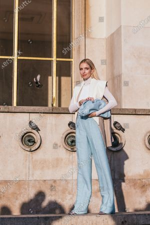 Leonie Hanne attends the Rochas show wearing pastel tones. Max Mara troussers, a leather waist coat by Phillip Lim and a Bottega Veneta bag outside the Rochas show during Paris Fashion Week Womenswear Fall/Winter 2020/2021