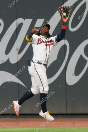 Atlanta Braves right fielder Ronald Acuna Jr. catches a fly ball off the bat of Miami Marlins' Brian Anderson to end a baseball game in the ninth inning, in Atlanta