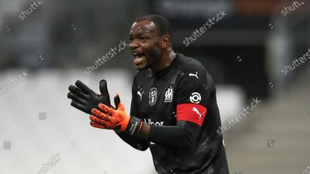 Marseille's goalkeeper Steve Mandanda cheers on his teammates during the French League One soccer match between Marseille and Saint Etienne at the Stade Velodrome in Marseille, France, Thursday, Sept.17, 2020