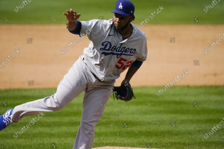 Los Angeles Dodgers relief pitcher Pedro Baez (52) in the seventh inning of a baseball game, in Denver. Tor Rockies won 6-3
