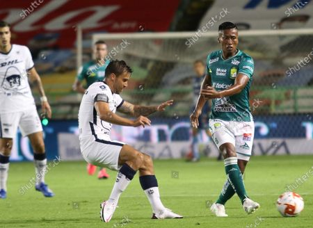 Leon's Pedro Aquino (R) vies for the ball against Andres Iniestra (L) of Pumas, during the 2020 Guardians of Mexico soccer tournament between Leon and Pumas, in Leon, Mexico, 21 September 2020.