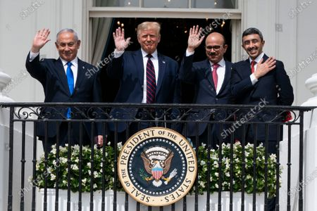 Israeli Prime Minister Benjamin Netanyahu, left, U.S. President Donald Trump, Bahrain Foreign Minister Khalid bin Ahmed Al Khalifa and United Arab Emirates Foreign Minister Abdullah bin Zayed al-Nahyan pose for a photo on the Blue Room Balcony after signing the Abraham Accords during a ceremony on the South Lawn of the White House in Washington. Saudi Arabia insists officially that there can be no formal ties with Israel before Palestinian statehood is achieved, but state-backed media and clerics have softened their tone toward Jews and there has been no official condemnation or criticism of the deals signed by the UAE or Bahrain with Israel