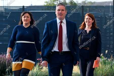 Britain's Labour leader Keir Starmer arrives with Ruth Smeeth, left and his political director Jenny Chapman, to deliver his keynote speech during the party's online conference from the Danum Gallery, Library and Museum in Doncaster, England, . Starmer will address party members in his first party conference since becoming leader in the wake of its worst defeat in a general election since 1935