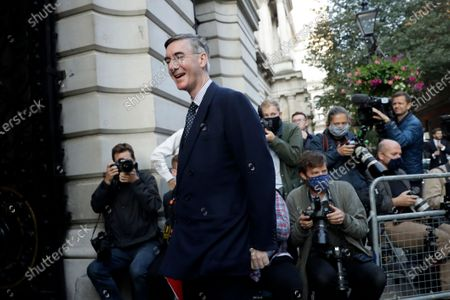 Jacob Rees-Mogg, Britain's Leader of the House of Commons, walks from Downing Street to attend a cabinet meeting at the Foreign and Commonwealth Office in London, . Britain's Prime Minister Boris Johnson plans to announce new restrictions on social interactions Tuesday as the government tries to slow the spread of COVID-19 before it spirals out of control