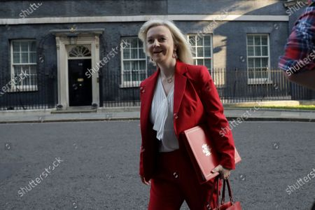 Liz Truss, Britain's Secretary of State for International Trade walks from Downing Street to attend a cabinet meeting at the Foreign and Commonwealth Office in London, . Britain's Prime Minister Boris Johnson plans to announce new restrictions on social interactions Tuesday as the government tries to slow the spread of COVID-19 before it spirals out of control