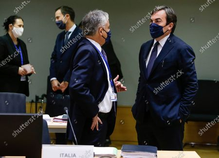 Italian Minister of European Affairs Vincenzo Amendola, right, attends a meeting of the General Affairs Council at the European Council building in Brussels, . European Union ministers meet Tuesday to discuss the stalemate in the Brexit negotiations and prospects to avoid a no-deal cliff-edge transition at the end of the year