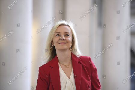 Britain's International Trade Secretary Elizabeth Truss arrives for a cabinet meeting at the FCO in London, . Britain's Prime Minister Boris Johnson plans to announce new restrictions on social interactions Tuesday as the government tries to slow the spread of COVID-19 before it spirals out of control