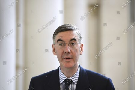 Britain's Leader of the House of Commons Jacob Rees-Mogg arrives for a cabinet meeting at the FCO in London, . Britain's Prime Minister Boris Johnson plans to announce new restrictions on social interactions Tuesday as the government tries to slow the spread of COVID-19 before it spirals out of control