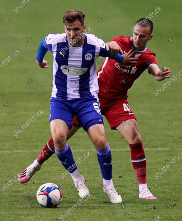 Lee Evans of Wigan Athletic and Liam Miller of Liverpool