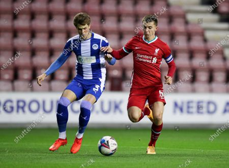 Tom Pearce of Wigan Athletic and Ben Woodburn of Liverpool