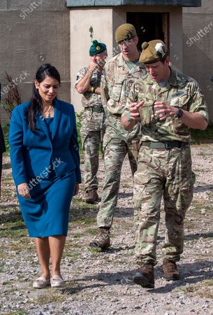 For years the Mail has fought to protect the brave translators who worked fearlessly with our troops in Afghanistan. Now, momentously, the Home and Defence Secretaries are giving them sanctuary here - in a joyous victory that burnishes Britain's honour  Priti Patel, Home Secretary, Defence Secretary