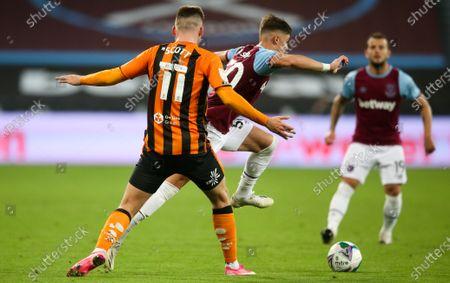 Stock Image of Harrison Ashby of West Ham skips past James Scott of Hull City