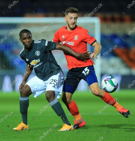 Tom Lockyer of Luton Town   battles with Odion Ighalo of Manchester United