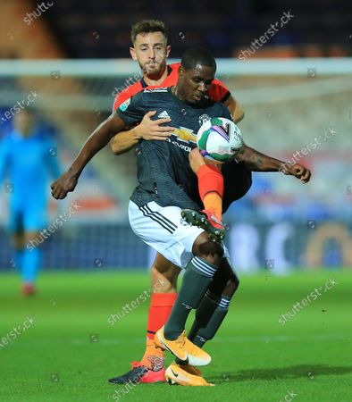 Odion Ighalo of Manchester United  battles with   Tom Lockyer of Luton Town