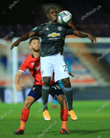 Odion Ighalo of Manchester United  controls the ball under pressure from  Tom Lockyer of Luton Town