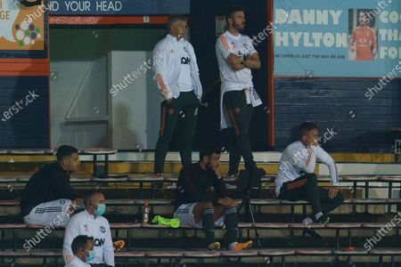 Manchester United Manager Ole Gunnar Solskjær and assistant Michael Carrick watch from the stands