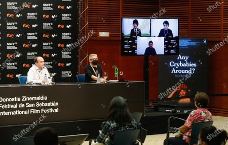 Japanese director Takuma Sato (on the screen, L), producer Hirokazu Koreeda (on the screen, bottom) and actor/cast member Nakano Taiga (on the screen, R), speak through video conference during the presentation press conference of the film 'Nakuko Wa Ineega' in the Official Section of the 68th edition of the San Sebastian International Festival, in San Sebastian, 22 September 2020.