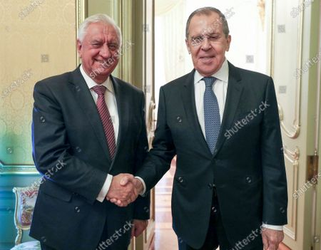 In this photo released by the Russian Foreign Ministry Press Service, Russian Foreign Minister Sergey Lavrov, right, and Chairman of the Board of the Eurasian Economic Commission Mikhail Myasnikovich pose for a photo prior to the talks in Moscow, Russia