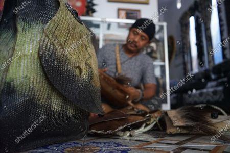 Editorial photo of Handicraft using Monitor Lizard Skin, Makassar, South Sulawesi, Indonesia - 22 Sep 2020
