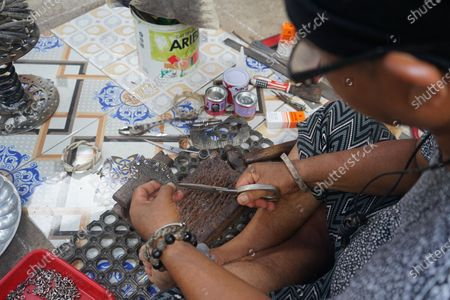 Editorial image of Handicraft using Monitor Lizard Skin, Makassar, South Sulawesi, Indonesia - 22 Sep 2020