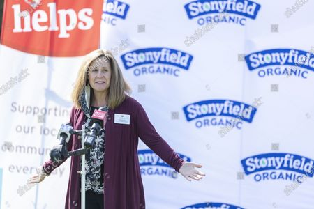 Stock Image of Cheryl Hinkson of Hannaford speaking at Fox Field in Kennedy Park., in Portland, Maine