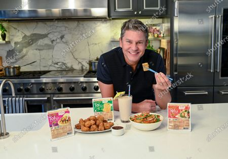 Stock Photo of David Burtka and House Foods celebrate the launch of The Tales of Tofu video series, in New York. The series aims to help children and families eat healthier through a fun story featuring little Tofu, alongside recipes. To watch, visit https://www.house-foods.com