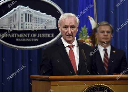 """Deputy Attorney General Jeffrey Rosen, announces a worldwide crackdown on opioid trafficking on the darknet with FBI Director Christopher Wray, right, during a press conference at the Department of Justice, in Washington. Law enforcement officials have arrested 179 people and seized more than $6.5 million. The operation announced Tuesday mainly occurred in the U.S. and in Europe. Rosen said the takedown showed """"there will be no safe haven for drug dealing in cyberspace"""