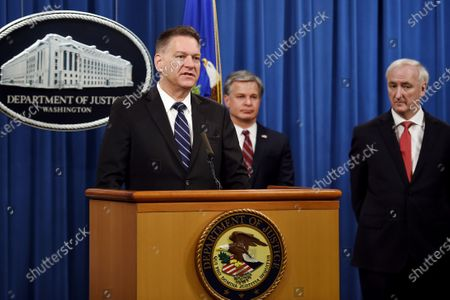 """Acting Administrator Timothy Shea, left, FBI Director Christopher Wray, center, and Deputy Attorney General Jeffrey Rosen, announce a worldwide crackdown on opioid trafficking on the darknet, during a press conference at the Department of Justice, in Washington. Law enforcement officials have arrested 179 people and seized more than $6.5 million. The operation announced Tuesday mainly occurred in the U.S. and in Europe. Rosen said the takedown showed """"there will be no safe haven for drug dealing in cyberspace"""