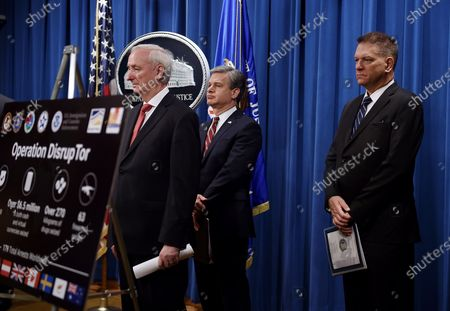 """Deputy Attorney General Jeffrey Rosen, announces a worldwide crackdown on opioid trafficking on the darknet with FBI Director Christopher Wray, center, and DEA Acting Administrator Timothy Shea, during a press conference at the Department of Justice, in Washington. Law enforcement officials have arrested 179 people and seized more than $6.5 million. The operation announced Tuesday mainly occurred in the U.S. and in Europe. Rosen said the takedown showed """"there will be no safe haven for drug dealing in cyberspace"""