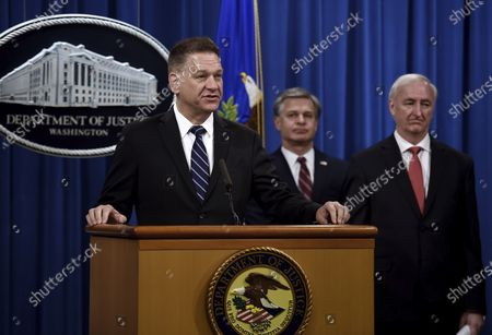 """Acting Administrator Timothy Shea, left, FBI Director Christopher Wray, center, and Deputy Attorney General Jeffrey Rosen, announces a worldwide crackdown on opioid trafficking on the darknet, during a press conference at the Department of Justice, in Washington. Law enforcement officials have arrested 179 people and seized more than $6.5 million. The operation announced Tuesday mainly occurred in the U.S. and in Europe. Rosen said the takedown showed """"there will be no safe haven for drug dealing in cyberspace"""