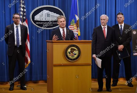 """Director Christopher Wray, center, ICE Acting Deputy Director Derek Benner, left, Deputy Attorney General Jeffrey Rosen, second from right, and DEA Acting Administrator Timothy Shea, right, announces a worldwide crackdown on opioid trafficking on the darknet, during a press conference at the Department of Justice, in Washington. Law enforcement officials have arrested 179 people and seized more than $6.5 million. The operation announced Tuesday mainly occurred in the U.S. and in Europe. Rosen said the takedown showed """"there will be no safe haven for drug dealing in cyberspace"""