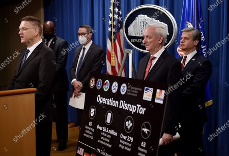 """From left, DEA Acting Administrator Timothy Shea, Chief Postal Inspector Gary Barksdale, ICE Acting Deputy Director Derek Benner, Deputy Attorney General Jeffrey Rosen, and FBI Director Christopher Wray, announce a worldwide crackdown on opioid trafficking on the darknet with FBI Director Christopher Wray, center, and DEA Acting Administrator Timothy Shea, during a press conference at the Department of Justice, in Washington. Law enforcement officials have arrested 179 people and seized more than $6.5 million. The operation announced Tuesday mainly occurred in the U.S. and in Europe. Rosen said the takedown showed """"there will be no safe haven for drug dealing in cyberspace."""" (Olivier Douliery/Pool via AP) ICE Acting Deputy Director Derek Benner"""