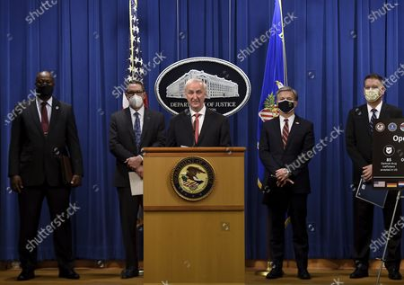 """From left, Chief Postal Inspector Gary Barksdale, ICE Acting Deputy Director Derek Benner, Deputy Attorney General Jeffrey Rosen, FBI Director Christopher Wray and DEA Acting Administrator Timothy Shea, announce a worldwide crackdown on opioid trafficking on the darknet with FBI Director Christopher Wray, center, and DEA Acting Administrator Timothy Shea, during a press conference at the Department of Justice, in Washington. Law enforcement officials have arrested 179 people and seized more than $6.5 million. The operation announced Tuesday mainly occurred in the U.S. and in Europe. Rosen said the takedown showed """"there will be no safe haven for drug dealing in cyberspace."""" (Olivier Douliery/Pool via AP) ICE Acting Deputy Director Derek Benner"""
