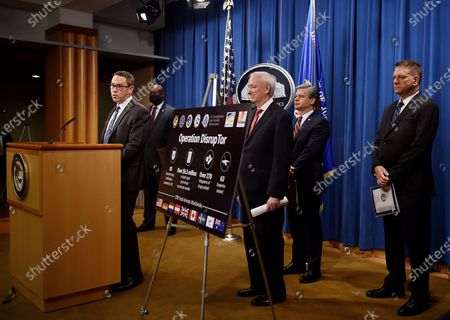 """From left, ICE Acting Deputy Director Derek Benner, Chief Postal Inspector Gary Barksdale, Deputy Attorney General Jeffrey Rosen, FBI Director Christopher Wray and DEA Acting Administrator Timothy Shea, announce a worldwide crackdown on opioid trafficking on the darknet, during a press conference at the Department of Justice, in Washington. Law enforcement officials have arrested 179 people and seized more than $6.5 million. The operation announced Tuesday mainly occurred in the U.S. and in Europe. Rosen said the takedown showed """"there will be no safe haven for drug dealing in cyberspace"""