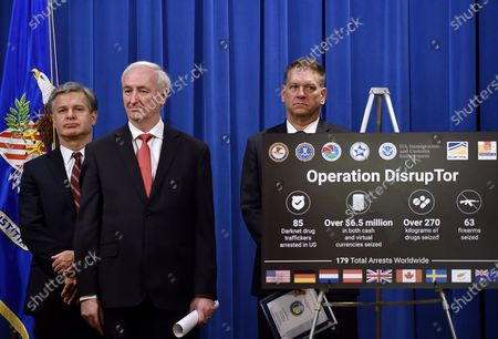 """From left, FBI Director Christopher Wray, Deputy Attorney General Jeffrey Rosen and DEA Acting Administrator Timothy Shea, announce a worldwide crackdown on opioid trafficking on the darknet, during a press conference at the Department of Justice, in Washington. Law enforcement officials have arrested 179 people and seized more than $6.5 million. The operation announced Tuesday mainly occurred in the U.S. and in Europe. Rosen said the takedown showed """"there will be no safe haven for drug dealing in cyberspace"""