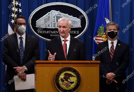 """From left, ICE Acting Deputy Director Derek Benner, Deputy Attorney General Jeffrey Rosen and FBI Director Christopher Wray, announce a worldwide crackdown on opioid trafficking on the darknet, during a press conference at the Department of Justice, in Washington. Law enforcement officials have arrested 179 people and seized more than $6.5 million. The operation announced Tuesday mainly occurred in the U.S. and in Europe. Rosen said the takedown showed """"there will be no safe haven for drug dealing in cyberspace"""