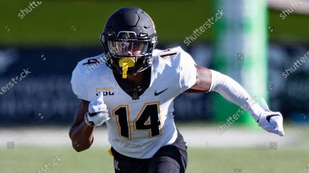Appalachian State Mountaineers wide receiver Malik Williams (14) runs during an NCAA football game against the Marshall Thundering Herd on in Huntington, W.VA