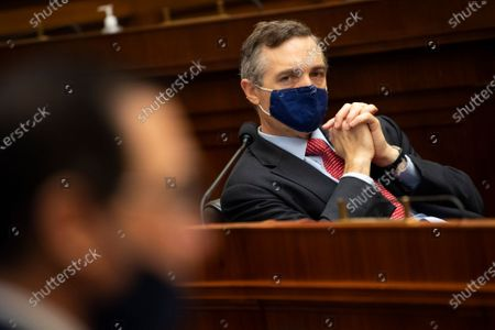 Rep. Van Taylor, R-Texas, listens as Treasury Secretary Steve Mnuchin testifies during a House Financial Services Committee hearing about the government's emergency aid to the economy in response to the coronavirus on Capitol Hill in Washington on