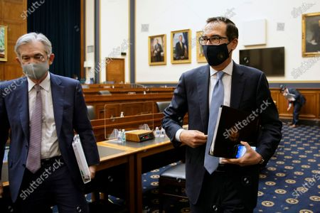 Federal Reserve Chair Jerome Powell, left, and Treasury Secretary Steve Mnuchin leave after a House Financial Services Committee hearing about the government's emergency aid to the economy in response to the coronavirus on Capitol Hill in Washington on