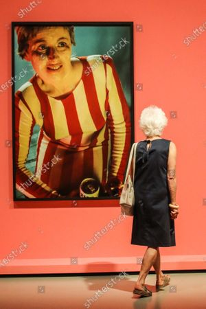 A visitor looks at the artwork entitled 'Untitled 132, 1984' by US artist Cindy Sherman during the exhibition 'Cindy Sherman at Fondation Louis Vuitton' held at the Louis Vuitton Foundation in Paris, France, 22 September 2020. The exhibition running from 23 September 2020 to 03 January 2021 brings together some 170 works by the artist, produced between 1975 and 2020. After being closed because of the health crisis sparked by the COVID-19 pandemic, The Fondation Louis Vuitton will reopen to the public from 23 September 2020.