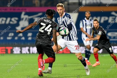West Bromwich Albion midfielder Sam Field (28) battles for possession  with Brentford FC midfielder Tarique Fosu-Henry (24) during the EFL Cup match between West Bromwich Albion and Brentford at The Hawthorns, West Bromwich