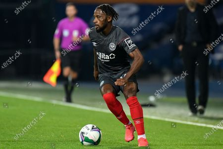 Brentford FC midfielder Tarique Fosu-Henry (24) sprints forward with the ball during the EFL Cup match between West Bromwich Albion and Brentford at The Hawthorns, West Bromwich