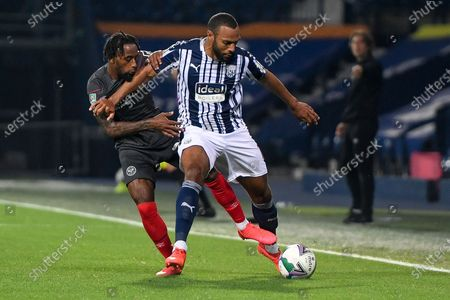 West Bromwich Albion midfielder Matt Phillips (10) battles for possession  with Brentford FC midfielder Tarique Fosu-Henry (24) during the EFL Cup match between West Bromwich Albion and Brentford at The Hawthorns, West Bromwich